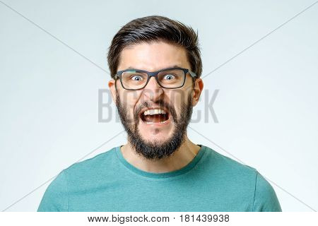 Angry And Furious Male On A Gray Background