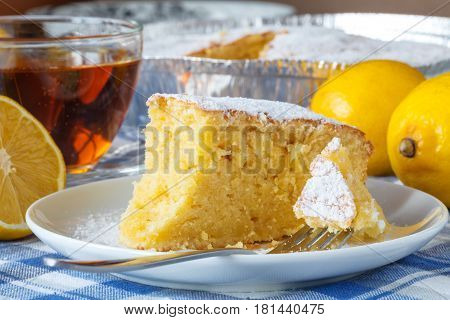 Emon Cake With Sugar Powder On The Wooden Table