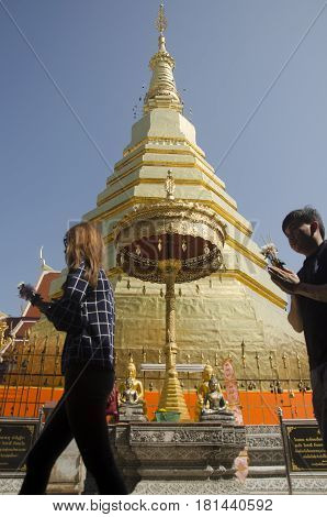 Asian Thai People Respect Pray And Travel And Posing Take Photo At Gold Chedi Of Wat Phra That Cho H