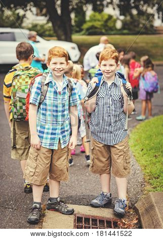 Twins waiting for the school bus