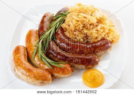 Traditional Octoberfest menu plate of sausages and sauerkraut. Oktoberfest meal.