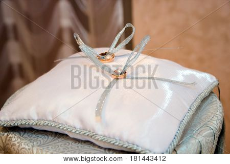 Image of wedding rings on the pillow Wedding rings on the pillow