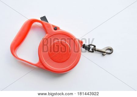 red automatic leash with hook on white background