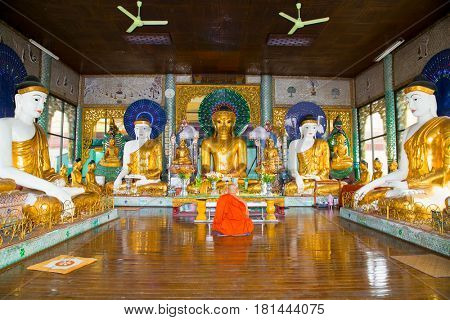 YANGON, MYANMAR-MARCH 2, 2017: Ascetic Buddhist monk meditating in  Shwedagon Paya pagoda on March 2, 2017 in Yangon. Myanmar. (Burama)
