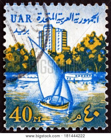 EGYPT - CIRCA 1964: a stamp printed in Egypt shows Sailing Boat on Nile and Tower Hotel circa 1964