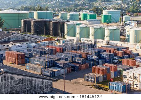 Victoria Mahe Island Seychelles - December 17 2015: Fuel storage and cargo containers stacked in shipping yard for transportation import export logistic industrial at Victoria Mahe Island Seychelles.