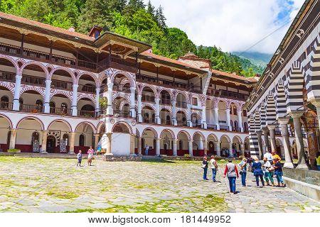 Rila, Bulgaria - June, 25, 2015: People in famous Rila Monastery, Rilsky monastery or Monastery of Saint Ivan of Rila. Unesco World Heritage site
