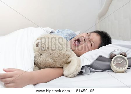 obese fat boy yawn and want to sleep in morning