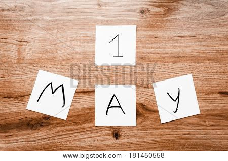 May 1st. Image of may 1. Spring day. International Workers' Day. Happy May Day vintage wood calendar