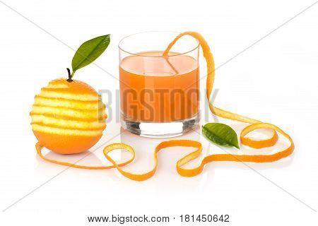 Orange with a leaf peeled in a spiral skin with a glass of poured juice on a white background original concept