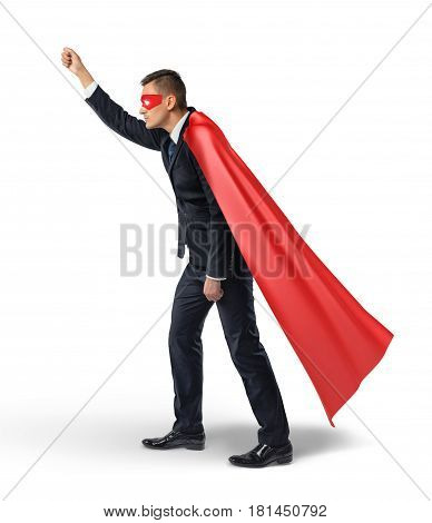 A businessman in a hero red cape and an eye mask standing in side view and holding an invisible signboard. Business communication. Warnings. Helpful information.