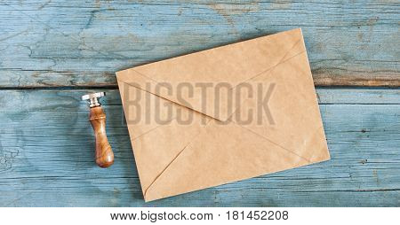 envelope with a stamp on the wooden background