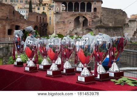 Rome Italy - April 2 2017: The cups and puppet mascot of the Rome Marathon which will be awarded to the winners in the various categories.