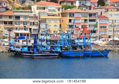 ISTANBUL - CIRCA JUNE 2015: Fishing boats preparing to deploy for fishing close to Istanbul, Turkey