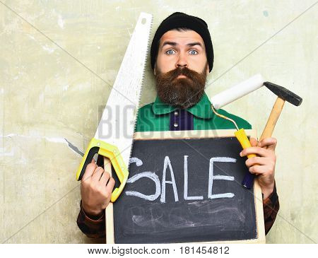 Bearded Man Holding Various Building Tools And Board, Surprised Face