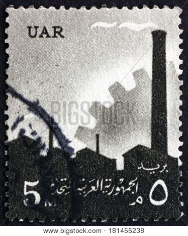EGYPT - CIRCA 1960: a stamp printed in Egypt shows Factory and Cogwheel Industry circa 1960
