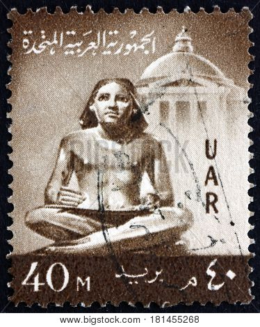 EGYPT - CIRCA 1959: a stamp printed in Egypt shows Scribe Statue circa 1959