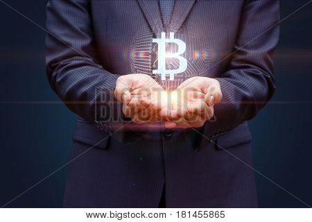 Business Man With Hands Offers Bit Coin.
