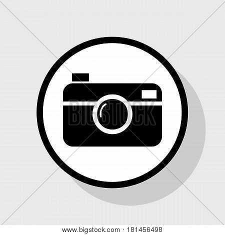 Digital photo camera sign. Vector. Flat black icon in white circle with shadow at gray background.