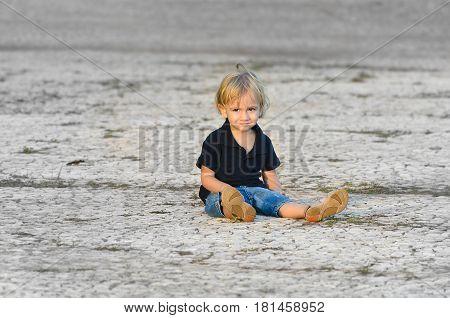 Sad Lonely Child Sitting On The Floor