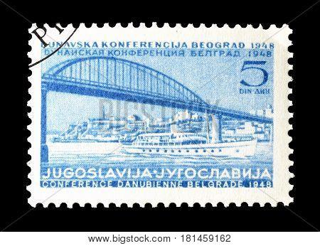 YUGOSLAVIA - CIRCA 1948 : Cancelled postage stamp printed by Yugoslavia, that shows Bridge and ship.