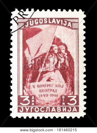 YUGOSLAVIA - CIRCA 1948 : Cancelled postage stamp printed by Yugoslavia, that shows People holding a flag.