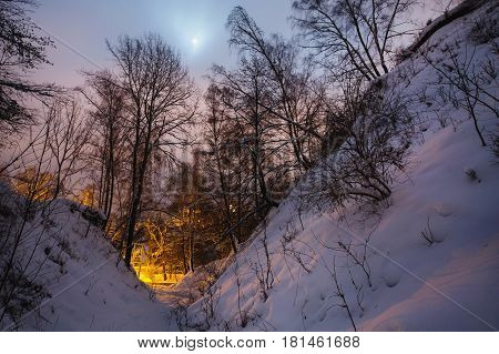 Winter beautiful starry night landscape. Astrophotography. Clear starry sky. Slow shutter speed. Beautiful landscape. Night landscape. Winter landscape. City landscape. Landscape with a view of the mountains. Lunar landscape. The spectacular sky. Scenic v