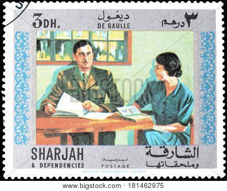 SHARJAH - CIRCA 1970 : Cancelled postage stamp printed by Sharjah, that shows General de Gaulle with a Lady.
