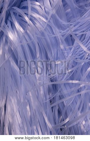 This is a photograph of Blue shredded plastic fake Easter grass background