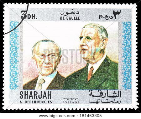 SHARJAH - CIRCA 1970 : Cancelled postage stamp printed by Sharjah, that shows General de Gaulle with Adenauer.