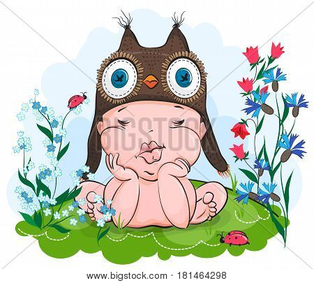 Baby sleeps in the header of an owl. The baby was asleep on a meadow in flowers