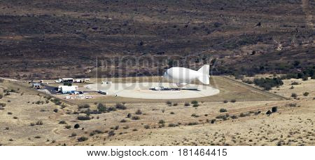 FORT HUACHUCA, ARIZONA, APRIL 8: An aerostat balloon moored on April 8, 2017, at Fort Huachuca, Arizona. Known as 'border balloons' and 'drug balloons' these tethered balloons are used to monitor illegal activity along the border between the US and Mexico