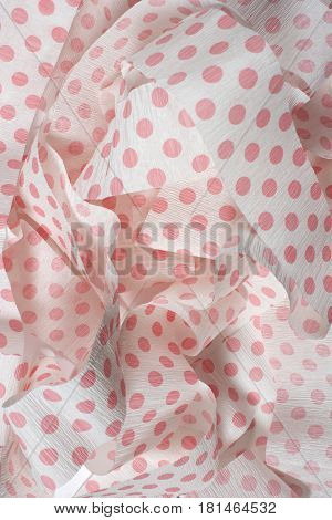 This is a photograph of Pink polka dot Crepe paper streamers