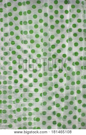 This is a photograph of Green Polka dot Crepe paper streamers