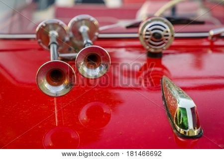 Close-up image of horns and hood details of a classic amphibious car