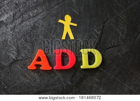 ADD (Attention Deficit Disorder) spelled out in play letters with paper child cutout
