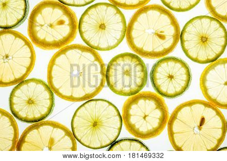 Bright Citrus Lime And Lemon Slices On White