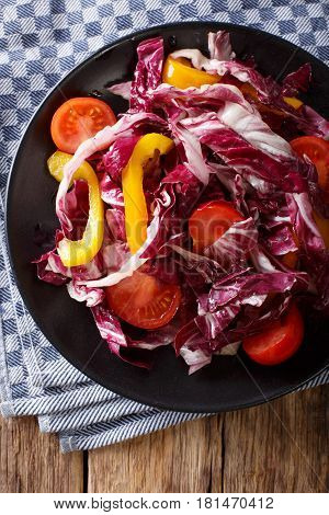Radicchio Salad With Tomatoes And Sweet Peppers Closeup. Vertical Top View