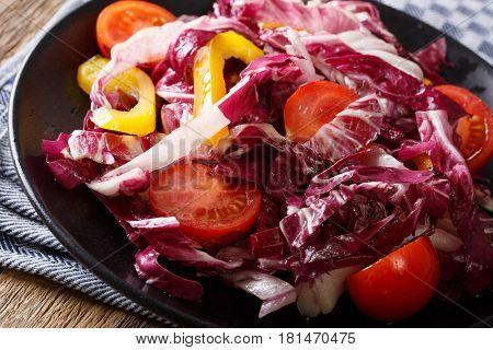 Radicchio Salad With Tomatoes And Pepper Closeup. Horizontal