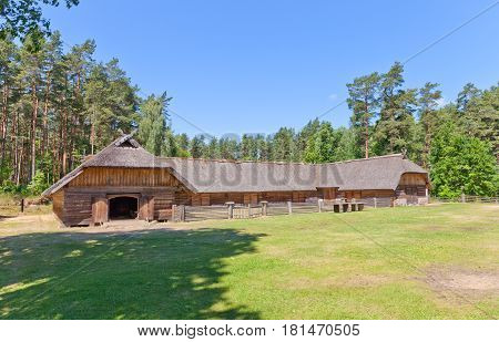 RIGA LATVIA - JUNE 13 2016: Horseshoe-shaped cattle-yard (circa 19th c.) of Veskerves farmstead of Kurzeme ethnic group. Exhibited in Ethnographic Open-Air Museum of Latvia since 2004