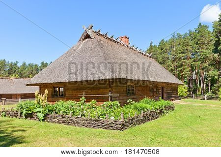 RIGA LATVIA - JUNE 13 2016: Dwelling rural house (circa 1848) of Veskerves farmstead of Kurzeme ethnic group. Exhibited in Ethnographic Open-Air Museum of Latvia since 2001