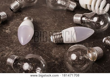 LED bulb incandescent lamp fluorescent lamp on a dark marble background. To save energy. Eco concept