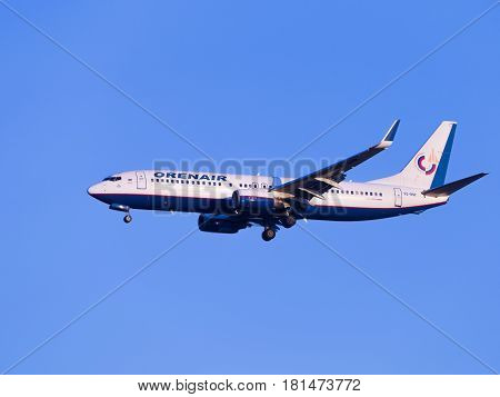 Sochi - April 3 2017: Powerful passenger plane Boeing 737-8K5 Orenair airlines land at Sochi airport in the evening against a clear blue sky April 3 2017 Sochi Russia