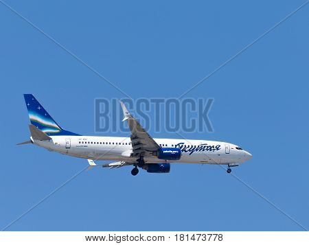 Sochi - April 3 2017: Powerful passenger plane Boeing 737-86N Yakutia Airlines makes a landing at the Sochi airport in the evening against a clear blue sky April 3 2017 Sochi Russia