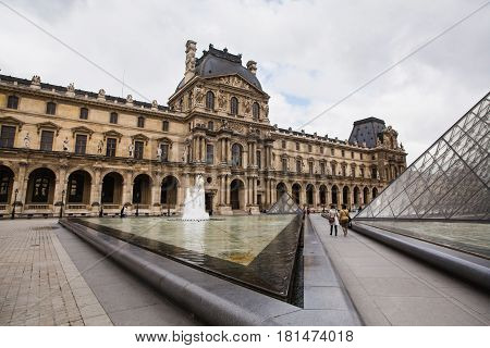 The Louvre in Paris the largest museum in the world. Louvre Pyramid. Travel through Europe. Attractions in France.