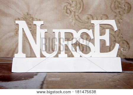 A white nurse table top sign decoration