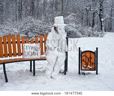 Alexander Pushkin famous poet is made from snow. (the text on the plate: PUSHKIN)