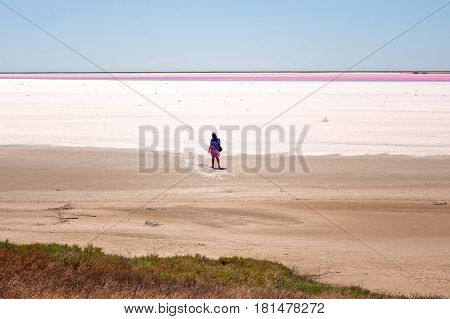 Man On The Red Salt Lake In Crimea, Russia