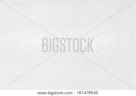White spotted tablecloth background. Material texture with little circles top view.