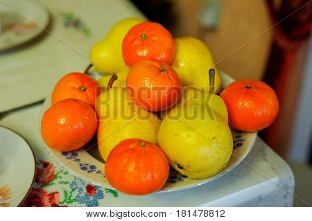 Tangerines with Pears are on the plate